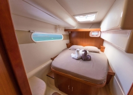 Caribbean kite cruise catamaran queen size bed cabin
